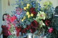 Large floral arrangement in blue, purple, red, yellow, and green