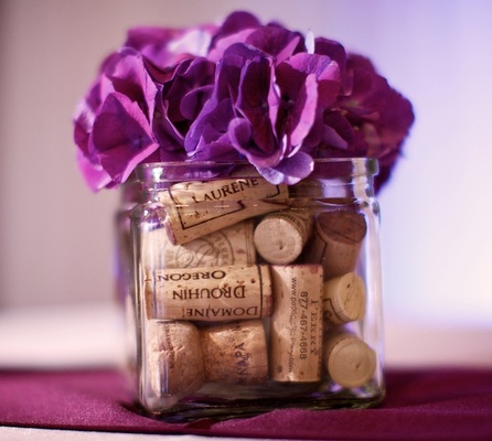 Wedding wine how to represent your love of wine in the dcor glass jars filled with wine corks and topped with flowers junglespirit Image collections