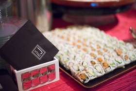 Sushi on tray at wedding cocktail hour food station