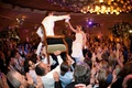 Jewish bride and groom being lifted on chairs