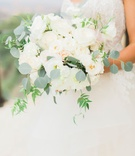 Bouquet with silver dollar eucalyptus white flowers dahlia rose light blush blooms peony greenery