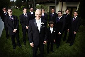 Groom with ring bearer and groomsmen in purple ties