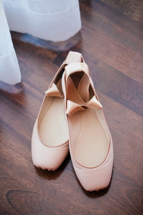 Ballet slippers worn by bride for horse ride to outdoor ceremony