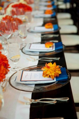 Blue and orange wedding reception decoration details