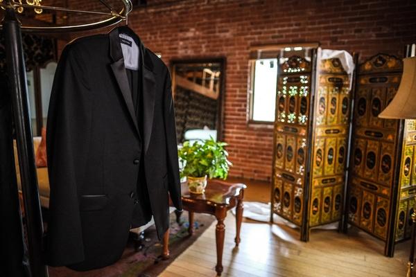tommy hilfiger tuxedo jacket hangs in groom's changing room Train bassist Hector Maldonado wedding
