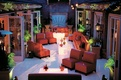 red couches and branch pattern lighting projection in craftsman style venue
