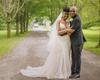 bride in eddy k lace dress, blush overskirt, horsehair veil, groom in suit