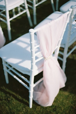 pink and white ceremony seating, white chiavari chairs