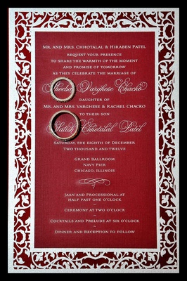 White motif-bordered invite with wedding bands