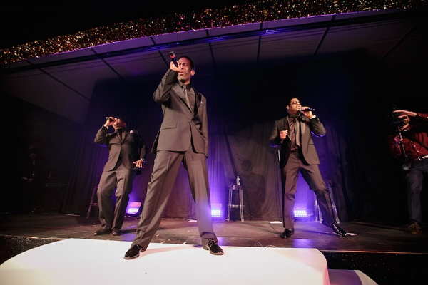 Boyz II Men perform at wedding reception in grey suits at Southern Hills Country Club