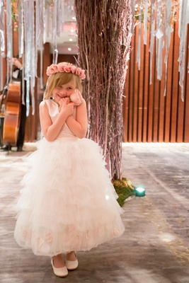 flower girl grasping pink rose flower crown fluffy gown new york city cute precious happy
