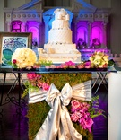 White wedding cake on garden-inspired stand