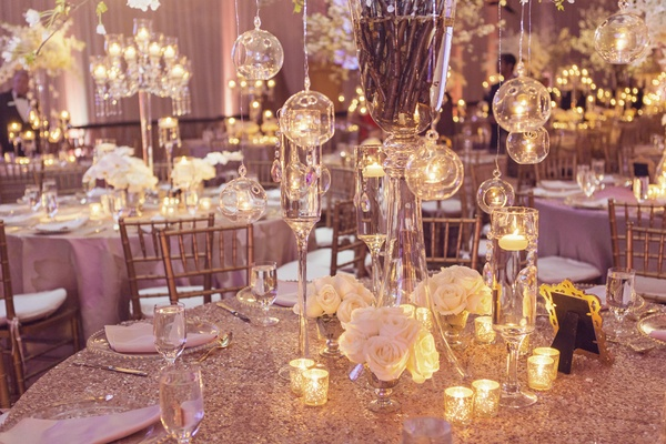 opulent wedding decor, centerpieces with glass orbs holding tea lights