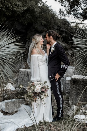 ashley castanos daughters of simone designer in boho chic off shoulder wedding dress with groom