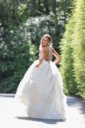 bride in hayley paige a line wedding dress with illusion back and jewel beading design