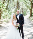 southern destination wedding couple bride in mark ingram atelier wedding dress groom in tuxedo tie
