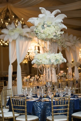 round table navy linen pattern feather arrangement north carolina wedding flowers crystals gold