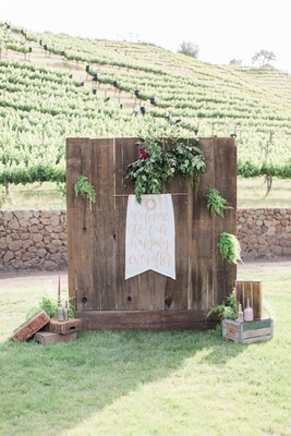 reception signage calligraphy wooden wall california boho chic wedding styled shoot greenery