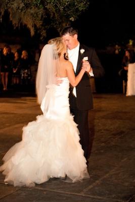 Bride and groom dancing at reception in wedding attire
