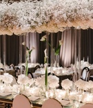 Baby's breath overhead flower arrangement on lucite column tall calla lily flowers white blooms