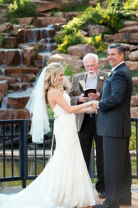 Bride smiles at groom during Montana wedding ceremony with family member officiant