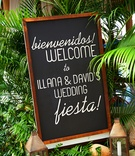 Tropical wedding fiesta sign on chalkboard in frame