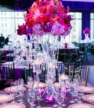 hydrangeas, stocks, orchids, lilies, roses, and phalenopsis in pink and purple, crystal strands