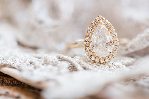 Yellow gold engagement ring with pave halo setting teardrop diamond pear shape wedding ring