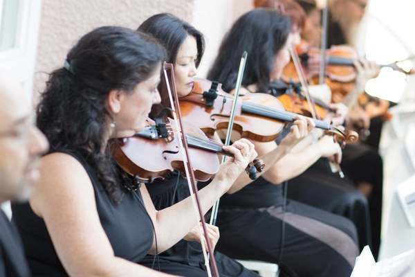 Wedding ceremony outdoor in beverly hills musicians in black dresses violin viola strings