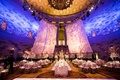 Gotham Hall wedding in new york city gatsby style wedding art deco gold palm leaves white flowers