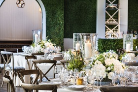 Boxwood lines the walls of this crisp, clean tented wedding reception, making a bold backdrop.