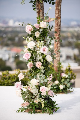 wedding ceremony four post structure chuppah pink