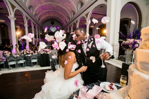 Amena Jefferson and Brandon Mebane cut cake