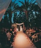 Sunset wedding ceremony under palm trees
