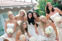 Long white bridesmaids dresses and mismatched bouquets