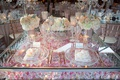 view of wedding sweetheart table silver pink rose petals crystals charger low centerpieces