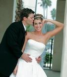 Groom kisses bride outside