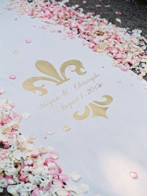 custom white aisle runner with bride and grooms names wedding date in gold lined white pink petals