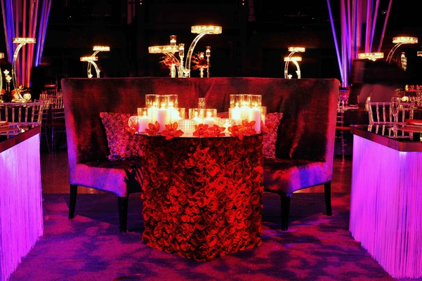 Sweetheart table with large bench and pillows