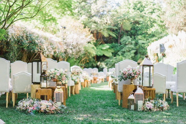 Lawn of Hotel Bel-Air wedding ceremony outdoor grey chairs wood legs wood side tables lanterns
