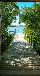 Dock leading to Sarasota Bay at Historic Spanish Point, Sarasota, FL