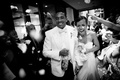 Black and white photo of bride and groom at reception exit
