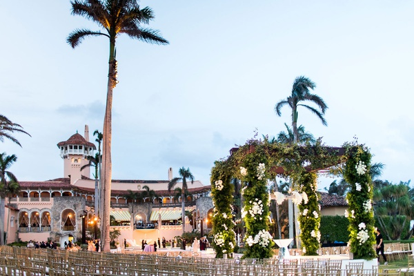 wedding ceremony at mar-a-lago club gold chairs seated in the round for clear view of ceremony