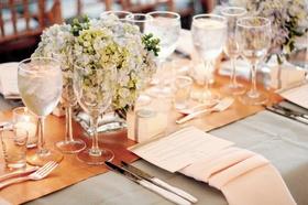 Orange runner atop light grey tablecloth