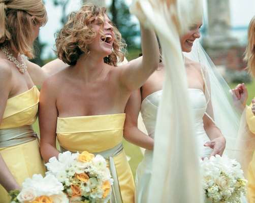 Bride celebrating with her fun bridesmaids