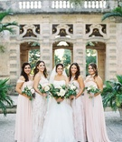 Bride in wedding dress with pink bridesmaid dresses green bouquets natural ribbon four bridesmaids