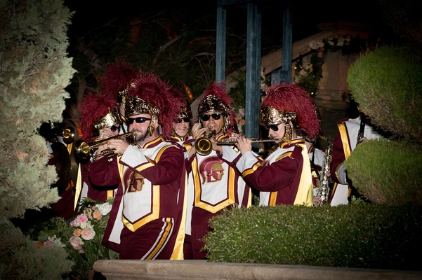 The University of Southern California Trojan marching band performing at evening wedding ceremony