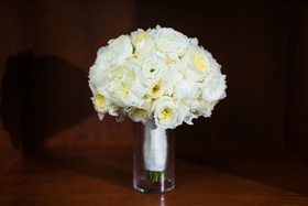 Ivory bouquet with ranunculus, peony, garden rose flowers in vase white ribbon wrap