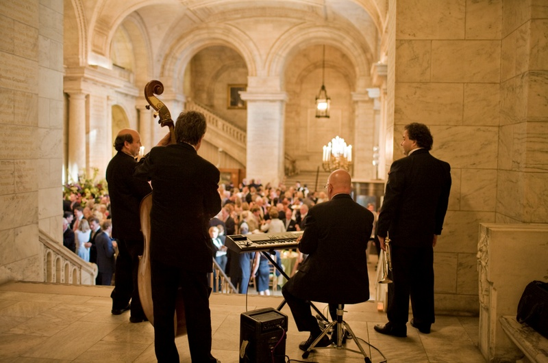 Four-person band performing for guests