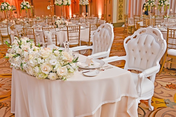 Bride and groom white tufted throne chairs